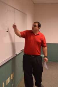 Prof. Tyler Maley teaching mathematics at MTC.