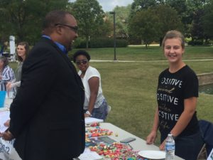 Jennafer Kibler, right, helps at a campus event. Rev. Shawn Jackson from OSU at Marion is left.