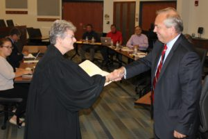 Kit Fogle is sworn in by Judge Deborah Alspach.