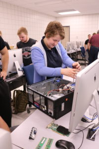 Students work on building computers.