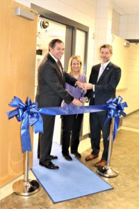 Photo of the three people holding the scissors for the ribbon cutting: Dr. Curt Gingrich, OhioHealth COO at Marion General Hospital; Luann Wilkinson, Science Professor at MTC; and Dr. Ryan McCall, President of MTC.