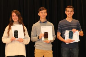 Pictures of the 12th grade winners holding their trophies