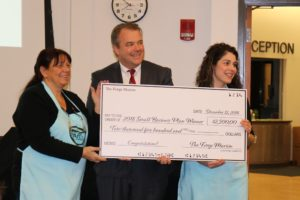 Winners Pia Douglas and Rachel McCall stand with the Forge Lars Olson holding their $2,500 check