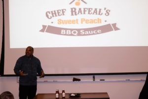 Chef Rapheal presents his peach bbq sauce to the judges