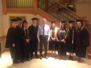 U.S. Senator Rob Portman stands with the high school students graduating with their associate's degrees.