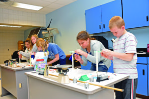Students do experiments in an engineering lab.