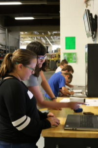Jodi Bennett demonstrates CAD with a student at RobotWorx.