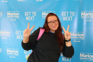 MTC student Bambi smiles on her first day of Fall Semester and gives the peace sign.