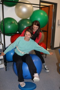 Students practice balancing in the PTA lab.