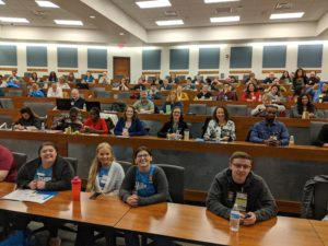 Attendees smile at the PTK conference.