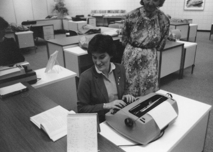 Women use typewriters in historical photos