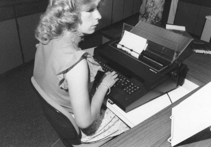 A woman uses a typewriter