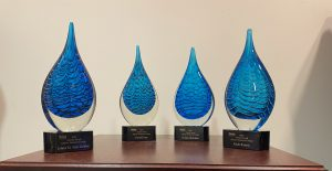 Photo of the awards - glass sculptures with the awardees' names